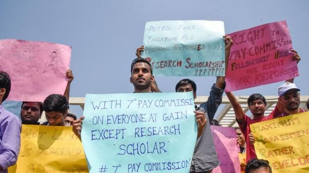 Silent march taken out by research scholars.(SANKET WANKHADE/ HT Photo)
