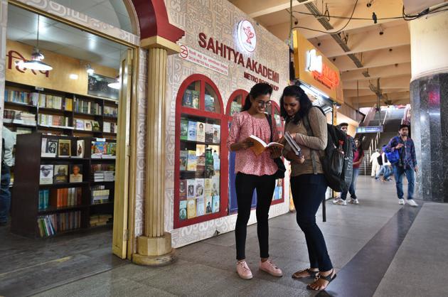 Bibliophiles indulged in reading joy at Kashmere Gate metro station's book store in New Delhi.(Raj K Raj)