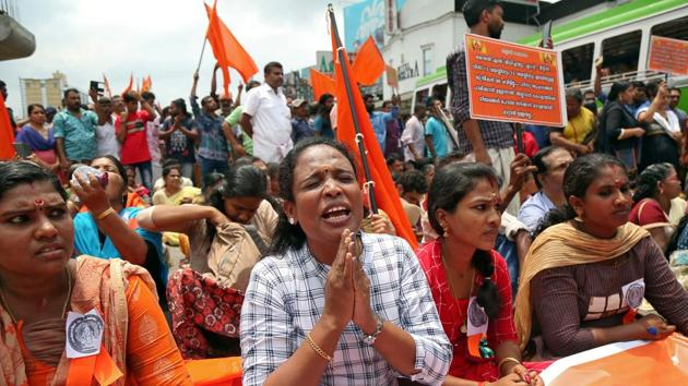 A woman chants hymns during a protest called by various Hindu organisations against the lifting of ban by Supreme Court that allowed entry of women to the Sabarimala temple, in Kochi, India, October 2, 2018(REUTERS)