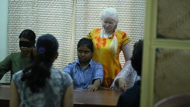 Shweta Varma, one of the blind trainers at National Association for Blind training students in the breast cancer course.(Athar Rather/HT Photo)