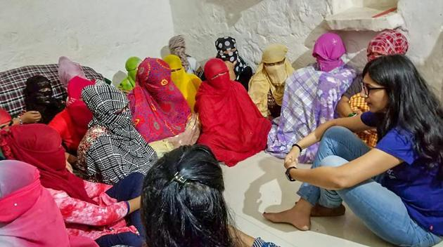 Delhi Commission for Women (DCW) chairperson, Swati Maliwal interacts with Nepali girls rescued from a hotel in Paharganj.(PTI FILE PHOTO)