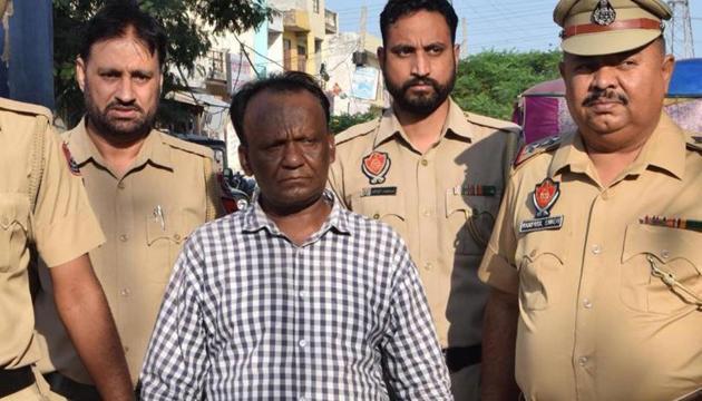 Accused Gorak Nath of Balongi in police custody.(HT Photo)