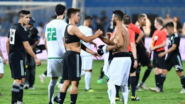 Soccer Football - International Friendly - Argentina v Iraq - Prince Faisal bin Fahd Stadium, Riyadh, Saudi Arabia - October 11, 2018 Argentina's Paulo Dybala shakes hands with Iraq's Hussam Kadhim after the match(REUTERS)