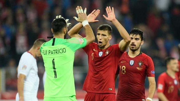 Soccer Football - UEFA Nations League - League A - Group 3 - Poland v Portugal - Silesian Stadium, Chorzow, Poland - October 11, 2018 Portugal's Rui Patricio and Ruben Dias celebrate after the match(REUTERS)