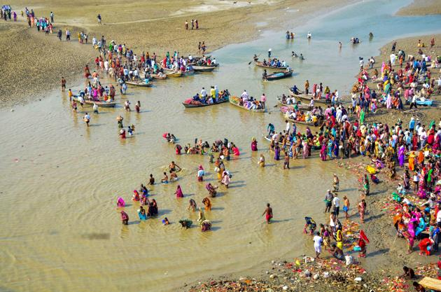 Devotees take a holy dip in River Ganga on the first day of the Navratri festival in Allahabad on October 10.(PTI File Photo)