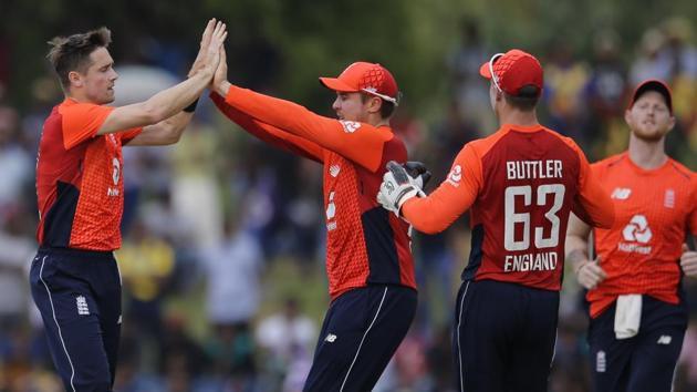 England's Chris Woakes, left, celebrates the dismissal of Sri Lanka's Dinesh Chandimal with his team mates during their second one-day international cricket match in Dambulla, Sri Lanka, Saturday, Oct. 13, 2018. (AP Photo/Eranga Jayawardena)(AP)