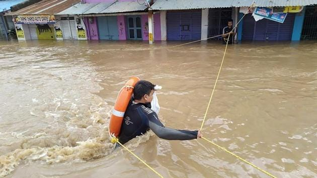 Rescue operation underway in flood-hit Aska area of Ganjam district, Odisha on Saturday.(PTI Photo)