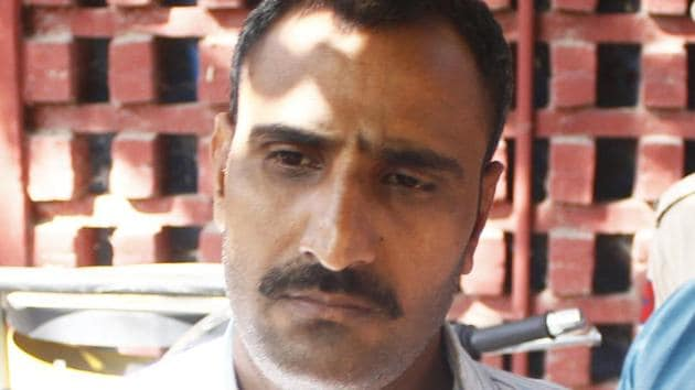 The accused Mahipal Singh, a head constable, who was arrested on Saturday evening was terminated from the police department and sent to police custody for four days by a city court on Sunday(Yogendra Kumar/HT Photo)