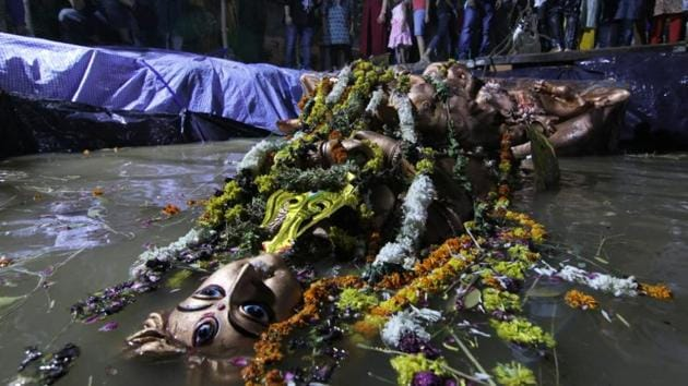 A Durga idol being immersed in an artificial pond created by a CR Park Puja Committee in 2017.(HT File Photo)