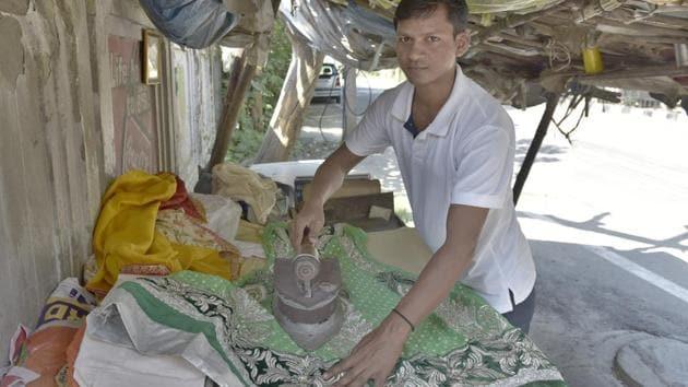 Umesh Kumar, a laundry man by profession, plays the role of Lord Rama in Sarabha Nagar Ramlila.(HT Photo)