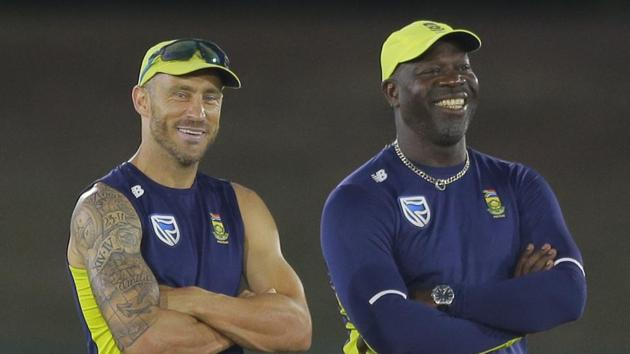South Africa's captain Faf du Plessis and coach Ottis Gibson attend a practice session.(AP)