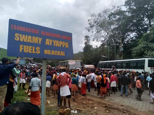 <p>Protestors block the road at Nilakkal base camp in Kerala. On Wednesday, at least three women journalists were attacked by an angry mob on their way to...