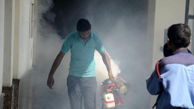File photo of a health worker fumigating a building in Gurugram. Dengue season usually starts in June and lasts until mid-December(HT File Photo)