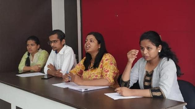 (From left to right) Sarika Aakhade, Deepak Chatap, Kalyani Mangave and Mrudgandha Dixit, members of the 'WeToo' committee, explain their objectives on Wednesday.(HT PHOTO)