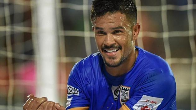 Mumbai City FC player Rafael Bastos celebrates after striking a goal against FC Pune City.(PTI)