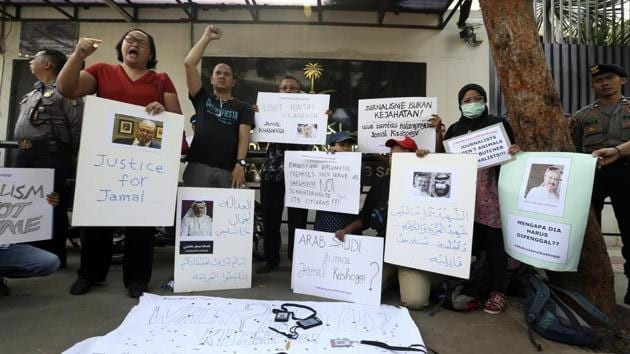 A dozen of Indonesian journalists hold posters with photos of Saudi journalist Jamal Khashoggi during a protest outside Saudi Arabian Embassy in Jakarta, Indonesia.(AP Photo)