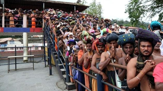 Devotees wait in queues inside the premises of the Sabarimala temple in Pathanamthitta district in Kerala, on October 17, 2018.(Reuters)