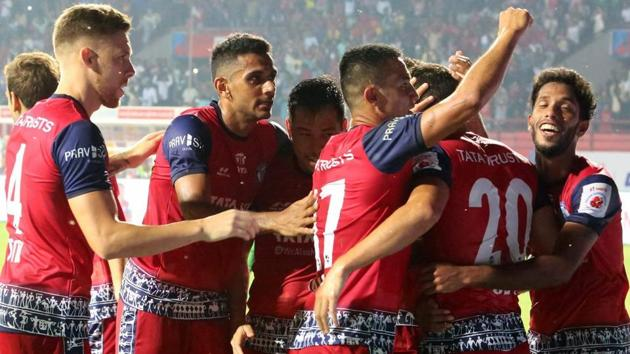 Players of Jamshedpur FC (Red jersey) celebrate after scoring a goal against ATK, Kolkata during the Indian Super League (ISL) football match 2018 .(PTI)