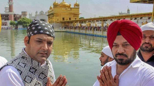 Kapil Sharma and Gurpreet Ghuggi offer prayers at Golden Temple, Amritsar during a promotion for their film Son Of Manjeet Singh on October 6, 2018.(PTI)