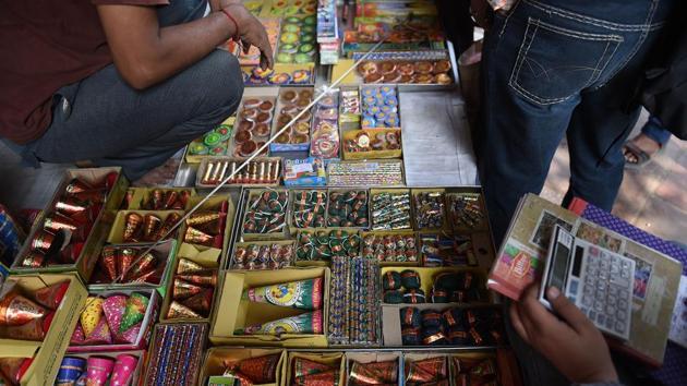 Customers visit a firecracker shop in New Delhi on October 23, 2018(AFP File Photo/Representative Image)
