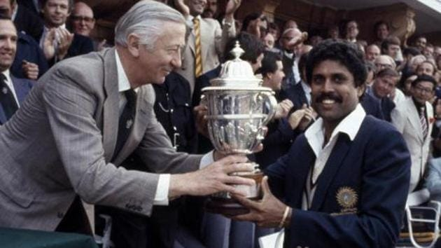 The captain of India, Kapil Dev, receives the Prudential World Cup Trophy from the Chairman of Prudential Assurance, Lord Carr of Hadley, after India's victory over the West Indies in the World Cup Final at Lord's cricket ground in London, 25th June 1983. India won by 43 runs.(Bob Thomas/Getty Images)