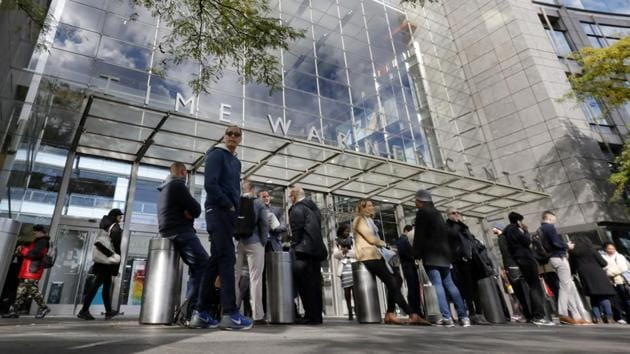 People gather outside the Time Warner Center, in New York on October 24.(AP Photo)