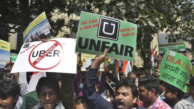 Drivers working for app-based taxis Uber and Ola protest outside Uber's office in Mumbai on Monday.(AP)