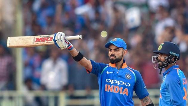 Virat Kohli raises his bat after completing 10,000 ODI runs during the second ODI match against West Indies.(PTI)