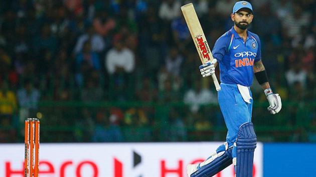 File photo of Indian cricket captain Virat Kohli raising his bat after reaching a milestone.(NurPhoto via Getty Images)