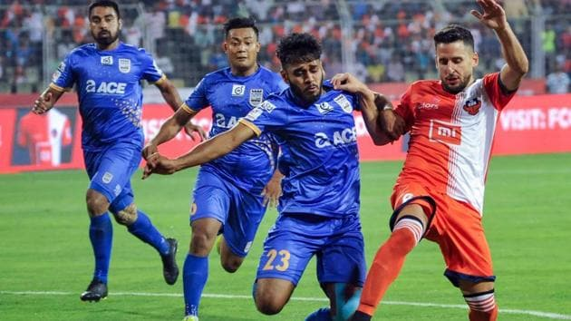 Players of FC Goa and Mumbai City FC in action in the 17th match of the 5th edition of ISL football tournament, at Nehru Stadium.(PTI)
