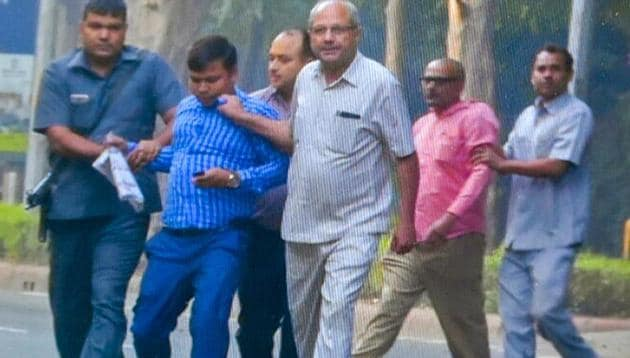 Two of the four men who were detained from outside the house of Alok Verma, who was stripped of charges as CBI chief on Wednesday.(PTI)