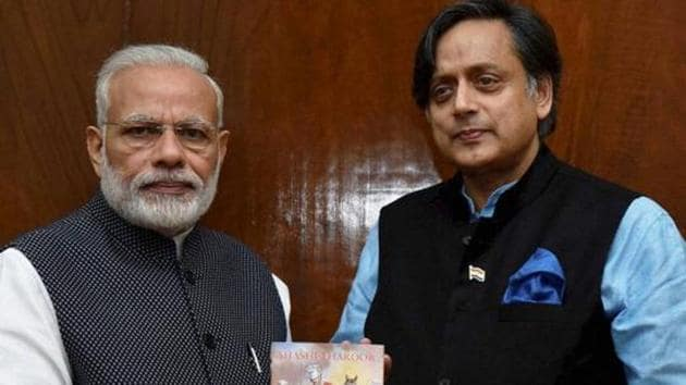 Congress MP Shashi Tharoor presents to Prime Minister Narendra Modi a copy of his book titled 'An Era of Darkness : The British Empire in India' in New Delhi on November 16, 2016.(PTI File Photo)