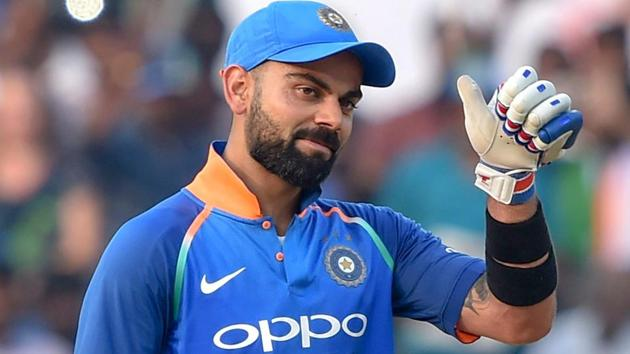 Virat Kohli reacts after completing his 10,000 runs in ODIs(PTI)