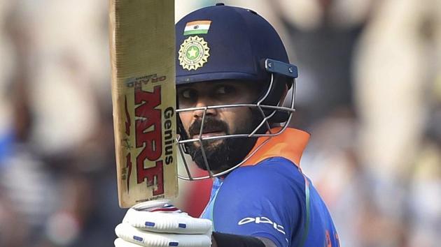 Virat Kohli raises his bat after scoring his century against West Indies.(PTI)