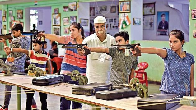 Johri Rifle Association patron and coach Rajpal Singh has made it a mission to help impoverished youngsters in Baghpat district realise their dreams.(Sanchit Khanna)