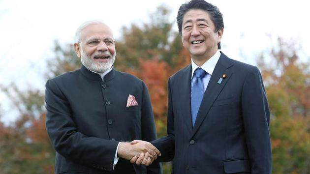 Prime Minister Narendra Modi shakes hands with his Japanese counterpart Shinzo Abe at a hotel in Yamanakako village, Yamanashi prefecture on October 28, 2018.(JIJI PRESS / AFP)