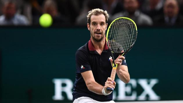 Richard Gasquet returns the ball to Denis Shapovalov during their men's singles first round match in the Paris Masters.(AFP)