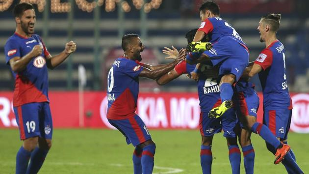 Bengaluru FC players celebrate scoring a goal against Jamshedpur FC during the Indian Super League (ISL).(AP)