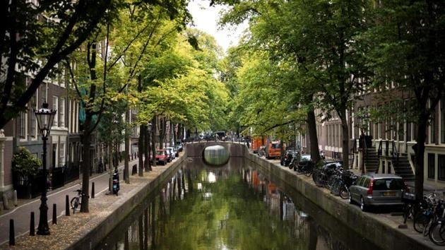 Amsterdam is one of the healthiest cities to live in and scored the highest in terms of average gym score, less obesity in adults, green spaces and work-life balance.(Unsplash)