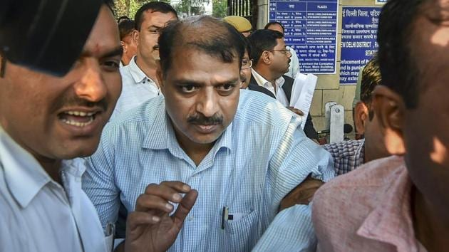 Deputy Superintendent of Police Devender Kumar after being produced at Patiala House Courts in New Delhi.(PTI file photo)