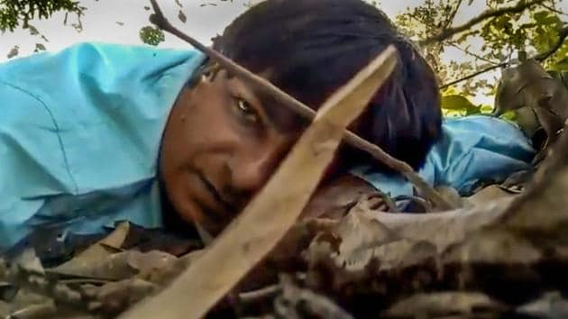 New Delhi: In this still from a video, Doordarshan camera assistant Mor Mukut records a message for his mother during a Maoist ambush that he survived, in Chhattisgarh's Dantewada district Tuesday, Oct 30, 2018. In the message Mormukt expressed his love for his mother and said he might not survive the attack. (Video Grab via PTI) (PTI10_31_2018_000161B)(PTI)