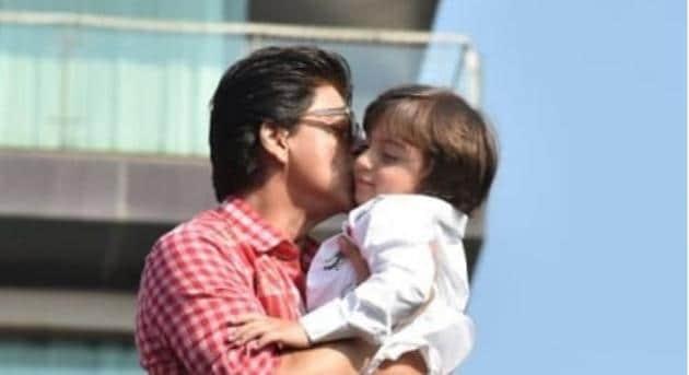 Shah Rukh Khan plants a kiss on AbRam's cheek as he greets his fans at his home, Mannat .