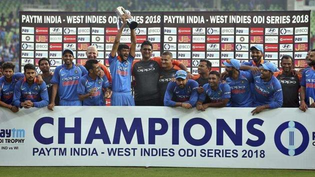 Khaleel Ahmed lifts the trophy after India beat Windies 3-1 in the series.(AFP)