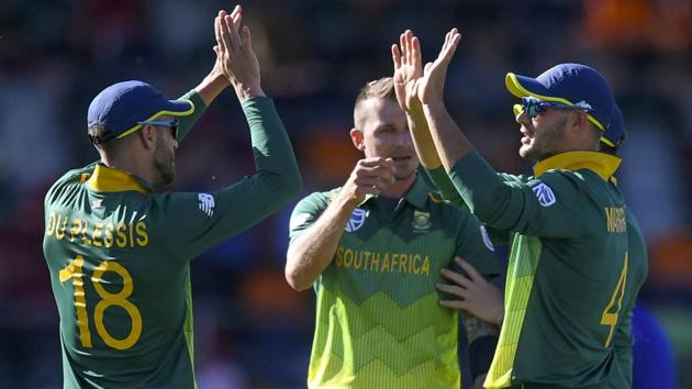 Aiden Markram, right, of South Africa celebrates with teammates after taking a wicket during a tour warm-up match.(AP)