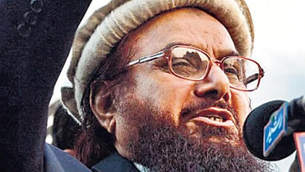 A special NIA court has issued non-bailable warrants against Pakistan-based Lashkar-e-Taiba founder Hafiz Saeed and Hizbul Mujahideen chief Syed Salahuddin for their involvement in terror funding activities, officials said Friday.(HTPhoto)