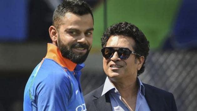 Virat Kohli and Sachin Tendulkar before the 4th ODI cricket match between India and West Indies at Brabourne Stadium.(AP)