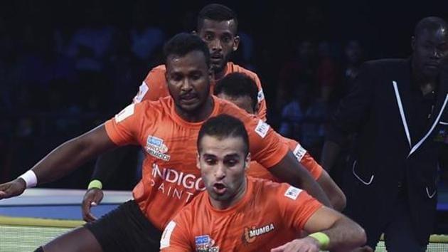 Chennai: U Mumba (Orange) players in action during their Pro Kabaddi league season 6 match.(AP)