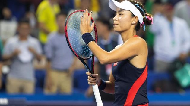 Wang Qiang of China reacts during her women's singles semi-final match against Garbine Muguruza of Spain in the Zhuhai Elite Trophy tennis tournament in Zhuhai(AFP)