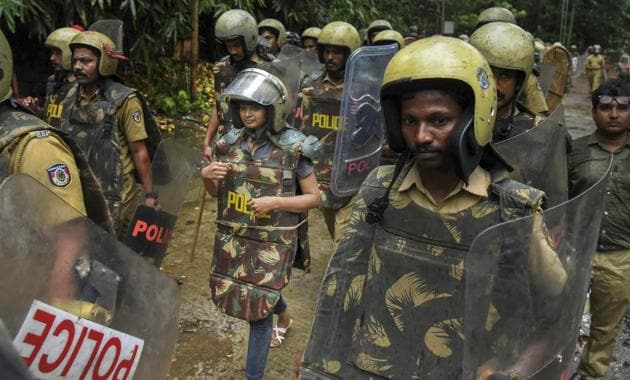 Journalist Kavitha Jakkal being escorted by the police to Sabarimala Temple, Kerala, October 19. Kavitha and activist Rehana Fathima were taken to the temple but the priest, reportedly, locked it and the women had to return mid-way.(PTI)