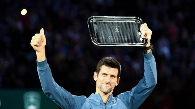 TOPSHOT - Second placed Serbia's Novak Djokovic poses with his trophy after the men's singles final tennis match against Russia's Karen Khachanov.(AFP)